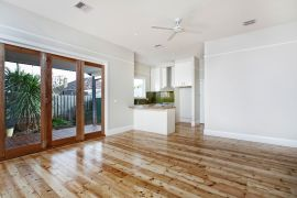 Open plan living with polsihed floors